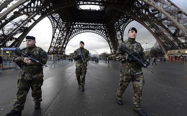 French soldiers patrol in front of the Eiffel Tower on January 8, 2015.(AFP/Bertrand Guay)