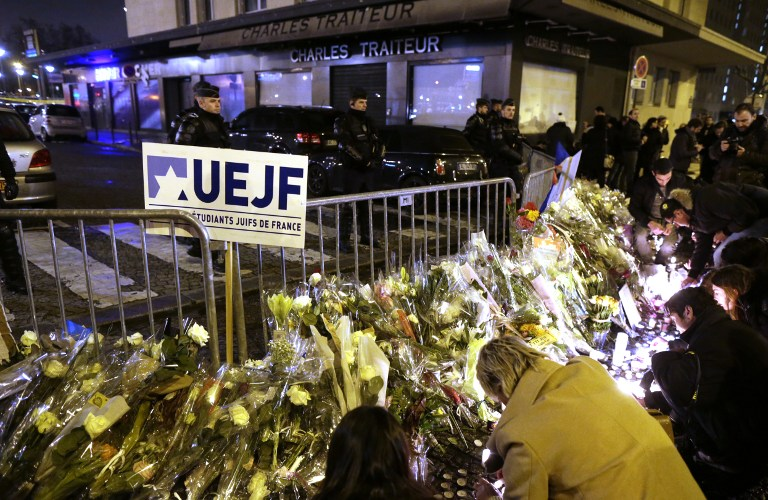 People place candles on January 10, 2015 during a demonstration at the end of Shabbat called by the Jewish Student's Union of France at the Porte de Vincennes in eastern Paris in homage to the four victims of the January 9 attack at a kosher supermarket. (photo credit: AFP/KENZO TRIBOUILLARD)