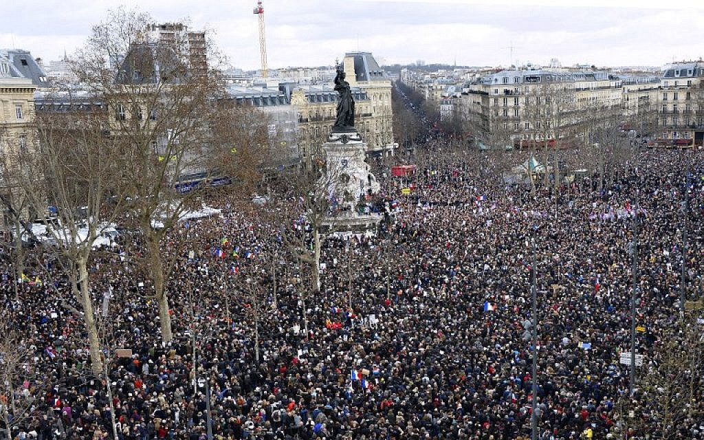 People gather on the Place de la Republique in Paris before the start of a Unity rally on January 11, 2015, in tribute to the 17 victims of a three-day killing spree by Islamic fundamentalists. (AFP/Bertrand Guay)