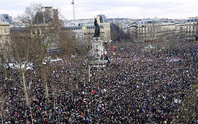 People gather on the Place de la Republique (Republic Square) in Paris before the start of a Unity rally on January 11, 2015, in tribute to the 17 victims of a three-day killing spree by homegrown Islamists (photo credit: AFP/BERTRAND GUAY)