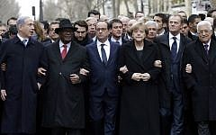 French President Francois Hollande (3rd L) is surrounded by head of states (From L to R : Prime Minister Benyamin Netanyahu, Ibrahim Boubakar Keita of Mali, Chancellor Angela Merkel of Germany, EU Council President Donald Tusk and Palestinian Authority President Mahmoud Abbas) as they attend the solidarity march (Marche Republicaine) in the streets of Paris January 11, 2015. (photo credit: AFP/POOL PHILIPPE WOJAZER)