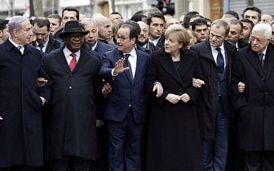 Prime Minister Benjamin Netanyahu, Malian President Ibrahim Boubacar Keita, French President Francois Hollande, German Chancellor Angela Merkel, European Union President Donald Tusk and Palestinian Authority President Mahmoud Abbas take part in a unity rally 'Marche Republicaine' in Paris on January 11, 2015 in tribute to the 17 victims of a three-day killing spree by homegrown Islamists. (Photo credit: AFP/ POOL / PHILIPPE WOJAZER)