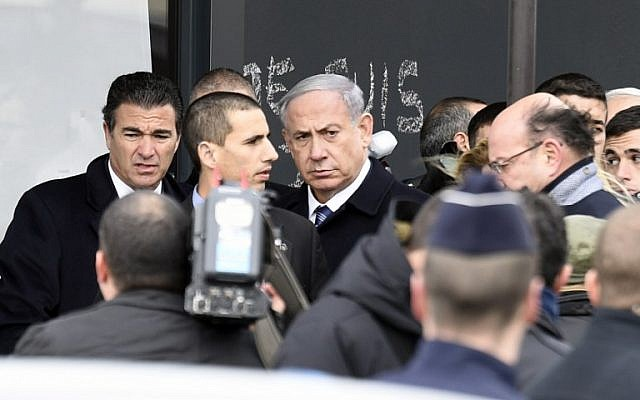 Prime Minister Benjamin Netanyahu (C) arrives at a kosher grocery store in Porte de Vincennes, eastern Paris, on January 12, 2015, where four people were killed in a terror attack (photo credit: AFP/MARTIN BUREAU)