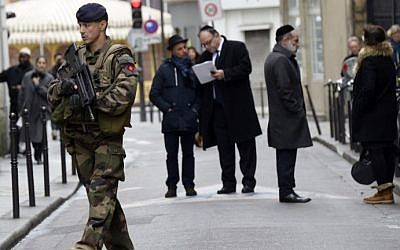 A French soldier patrols in the Jewish quarter of the Marais district, Paris, January 12, 2015. photo credit: AFP/Bertrand Guay)