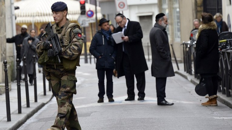 A French soldier patrols in the Jewish quarter of the Marais district, Paris, January 12, 2015. (AFP/ Bertrand Guay)