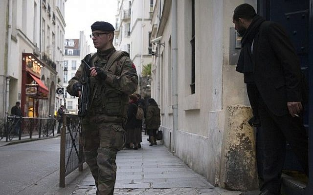 A French soldier patrols on January 12, 2015 near a Jewish school in Paris (photo credit: AFP/JOEL SAGET)
