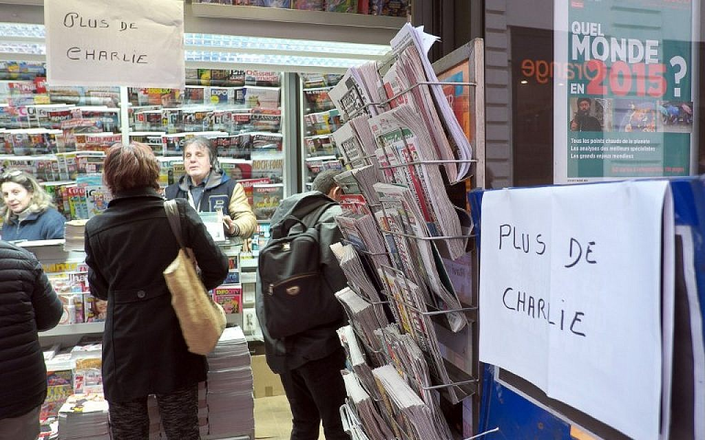 """A sign which translates as """"Charlie Hebdo - Sold Out"""" is displayed at a newsagents kiosk in Marseille on January 14, 2015 shortly after the latest edition of the French satirical weekly went on sale. (photo credit: AFP PHOTO / BORIS HORVAT)"""