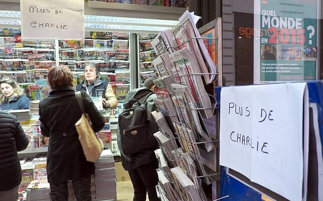 "A sign which translates as ""Charlie Hebdo - Sold Out"" is displayed at a newsagents kiosk in Marseille on January 14, 2015 shortly after the latest edition of the French satirical weekly went on sale. (photo credit: AFP PHOTO / BORIS HORVAT)"