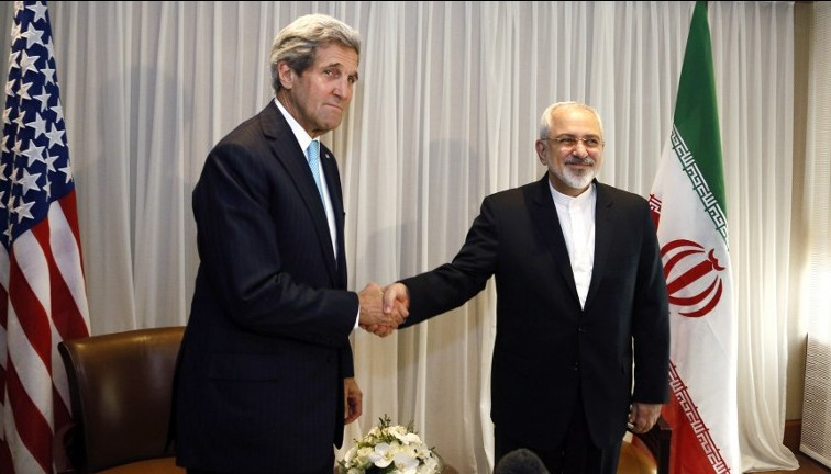 Iranian Foreign Minister Mohammad Javad Zarif (right) shakes hands with US Secretary of State John Kerry (left) in Geneva, January 14, 2015. (photo credit: AFP/Rick Wilking/Pool)