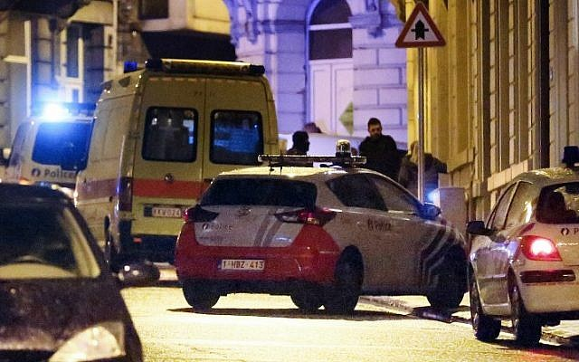 Police vehicles and vans are parked in a street as police set up a large security perimeter in the city center of Verviers, eastern Belgium, where two people were reportedly killed in an anti-terrorism operation on January 15, 2015. (photo credit: AFP/Belga/Bruno Fahy)