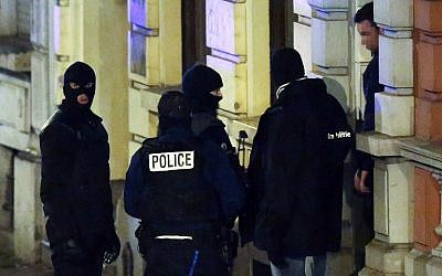 Belgian police exit a building in Verviers, eastern Belgium, on January 15, 2015. (photo credit: AFP/Belga/Bruno Fahy)