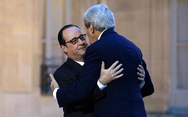 French President François Hollande welcomes US Secretary of State John Kerry prior,  January 16, 2015. (photo credit: AFP/Rick Wilking, Pool)