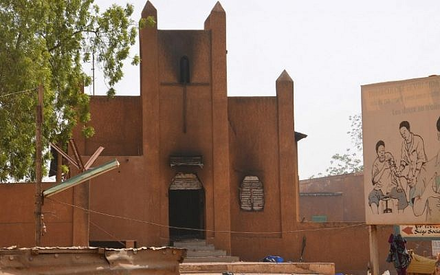 A damaged church after it was set on fire by protesters during a demonstration against French weekly Charlie Hebdo's publication of a cartoon of the Prophet Muhammed in Niamey, on January 17, 2015. (photo credit: AFP/Boureima Hama)