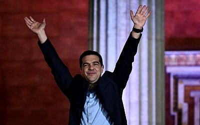 Syriza party leader Alexis Tsipras greets supporters following victory in the election in Athens, Greece, on January 25, 2015. (AFP/Aris Messinis)
