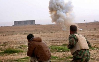 FILE: Kurdish peshmerga fighters detonate a landmine planted by the Islamic State (IS) group fighters on the outskirts of the village of Sinuni in the northern Iraqi district of Sinjar on January 15, 2015, after it was recaptured by Kurdish peshmerga troops. (Safin Hamed/AFP)