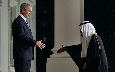 A file picture taken on November 14, 2008 shows Saudi King Abdullah (L) being greeted by then US President George W. Bush (R) on the North Portico of the White House in Washington, DC, prior to a dinner with leaders attending the Summit on Financial Markets. (Photo credit: AFP/ Files / Jim WATSON)