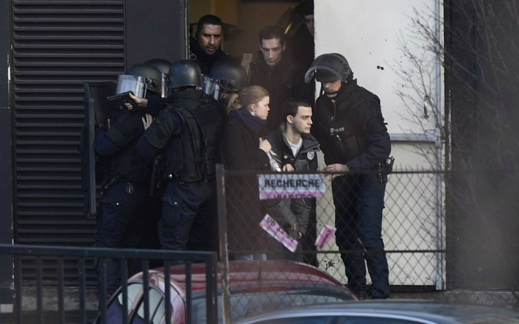 French police special forces evacuate residents in Porte de Vincennes, eastern Paris, after a gunman opened fire at a kosher grocery store, January 9, 2015. (photo credit: AFP/Martin Bureau)