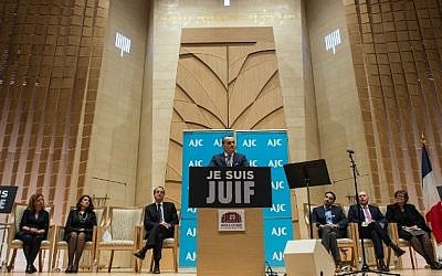 """French Ambassador to the US Gerard Araud addresses a """"Gathering of Solidarity and Remembrance with the People of France and Its Jewish Community"""" at the Adas Israel Congregation in Washington on January 13, 2015. (photo credit: AFP/NICHOLAS KAMM)"""