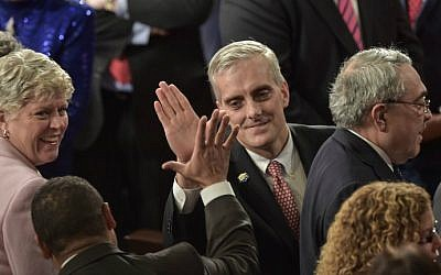 White House chief of staff Denis McDonough greets a member of Congress before US President Barack Obama delivers the State of the Union address at the US Capitol in Washington, January 20, 2015 (AFP/Nicholas Kamm)