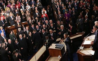 Members of Congress listen to US President Barack Obama deliver his State of the Union address in the House chamber of the US Capitol in Washington, DC, January 20, 2015. (AFP/Alex Wong)