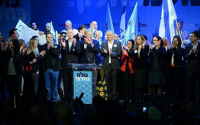 Kulanu party leader Moshe Kahlon surrounded by the party's Knesset candidates at a campaign kickoff event in Givat Brenner, January 15, 2015 (photo credit: courtesy/Facebook)