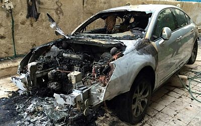 Mohammed Dajani's car, destroyed in an apparent arson attack, January 16, 2015. (Courtesy of Mohammed Dajani)