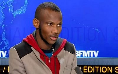 Lassana Bathily appearing on French television news channel BFMTV in the days after the attack on the Hyper Cacher supermarket in Paris on  January 9, 2015. (Screenshot from YouTube)