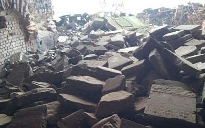 Jewish gravestones piled in a heap at the Brest Fortress in Belarus. (photo credit: Ilan Ben Zion/Times of Israel staff)