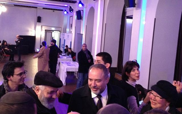 Israeli foreign minister Avigdor Liberman visits the Jewish Agency Aliya Salon in Paris, January 11, 2015 (photo credit: Elhanan Miller/Times of Israel)