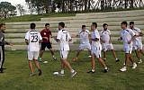 Palestinian soccer players warm up during a training session at the Asian Games athletes' village in Incheon, South Korea, September 19, 2014. (AP Photo/Rajshekhar Rao, File)
