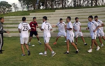 Palestinian football players warm-up during a training session at the Asian Games athletes' village in Incheon, South Korea, Friday, Sept. 19, 2014.  (AP Photo/Rajshekhar Rao, File)