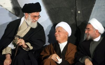 Iran's supreme leader Ayatollah Ali Khamenei, left, former president Akbar Hashemi Rafsanjani, center, and then top nuclear negotiator (now president) Hassan Rouhani, in Tehran, March, 9, 2006. (photo credit: AP Photo)