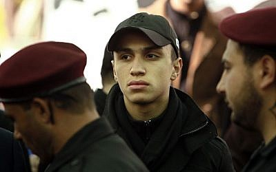 Jihad Mughniyeh sits during a memorial service for his father Imad in his hometown of Tair Debba, south Lebanon on Sunday, Feb. 17, 2008.  (photo credit: AP/Tara Todras-Whitehill)