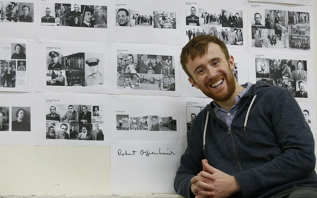 Actor John Heffernan poses with old photographs and a signature of Robert Oppenheimer, at a rehearsal studio in London. Heffernan is playing the part of Robert Oppenheimer in a new play the Royal Shakespeare Company is doing about the physicist, who led the team that developed the first nuclear weapon. (AP Photo/Kirsty Wigglesworth)