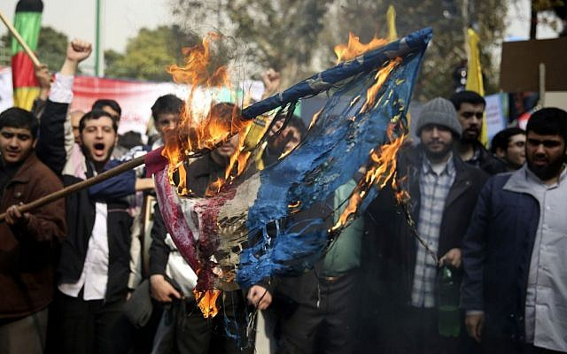 Iranian protesters burn an American flag during an annual anti-American rally in Tehran, Iran, Monday, Nov. 4, 2013 (photo credit: AP/Ebrahim Noroozi)