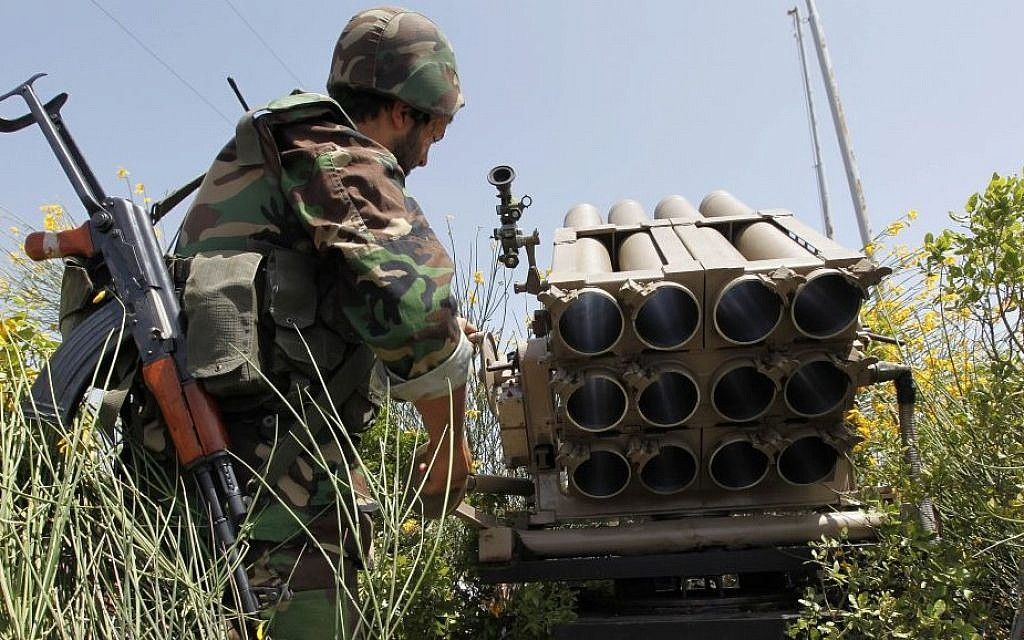 In this May 22, 2010 file photo, a Hezbollah fighter stands behind an empty rocket launcher while explaining to the group various tactics and weapons used against Israeli soldiers on the battlefield. (photo credit: AP/Hussein Malla)