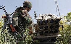 File: In this May 22, 2010 file photo, a Hezbollah fighter stands behind an empty rocket launcher while explaining various tactics and weapons used against Israeli soldiers on the battlefield (AP/Hussein Malla)