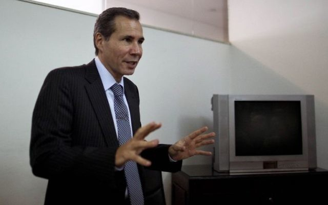 Alberto Nisman, the late prosecutor who investigated the 1994 bombing of the AMIA Jewish community center, talks to journalists in Buenos Aires, Argentina, Wednesday, May 29, 2013.  (AP Photo/Natacha Pisarenko)