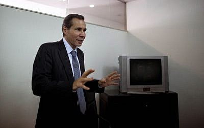 Alberto Nisman, the slain prosecutor investigating the 1994 bombing of the AMIA Jewish community center, talks to journalists in Buenos Aires, Argentina, Wednesday, May 29, 2013. (AP/Natacha Pisarenko)