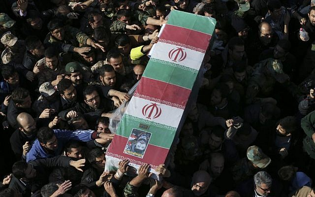 Illustrative: Civilians and members of the armed forces carry the flag draped coffin of Iranian Revolutionary Guard Brig. Gen. Mohammad Ali Allahdadi during his funeral ceremony outside the Guard compound in Tehran, Iran, January 21, 2015 (photo credit: AP/Vahid Salemi)