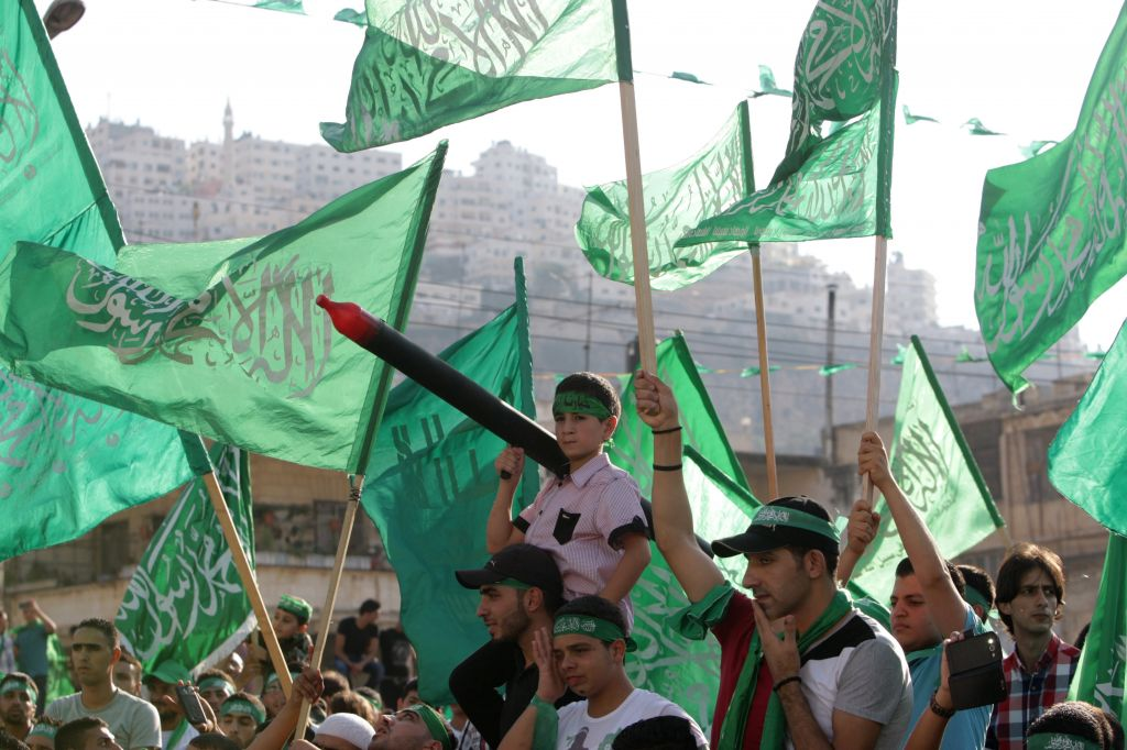 Palestinians hold Hamas flags and chant slogans during a celebration organized by Hamas in the West Bank city of Nablus, on Friday, August 29, 2014 (photo credit: AP/Nasser Ishtayeh)
