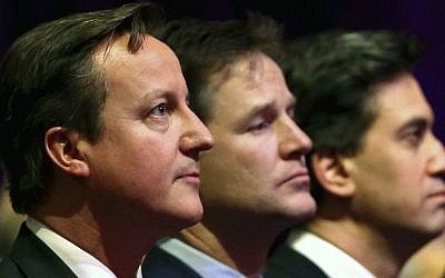 Britain's Prime Minister David Cameron, with Deputy Prime Minister Nick Clegg and Leader of the opposition Labour Party, Ed Miliband, attend a Holocaust Memorial Day ceremony at Central Hall Westminster, Tuesday Jan. 27, 2015, in London. The event in London with invited guests and dignitaries marks the International Holocaust Remembrance Day and commemorates the 70th anniversary of the liberation of the Nazi Auschwitz death camp. (photo credit: AP Photo / Chris Jackson, Pool)