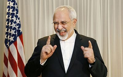 Iranian Foreign Minister Mohammad Javad Zarif laughs with reporters before meeting with US Secretary of State John Kerry in Geneva, Switzerland, Wednesday, Jan. 14, 2015 (photo credit: AP/Rick Wilking)