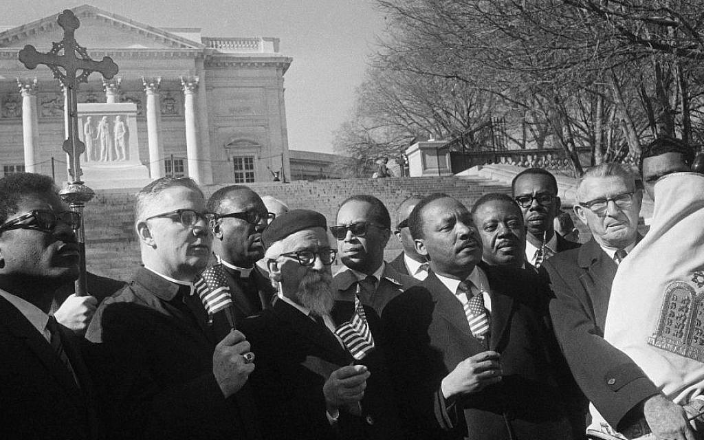 Illustrative: Leaders in a Vietnam war protest stand in silent prayer in Arlington National Cemetery, February 6, 1968, including Rabbi Abraham Heschel, and the Rev. Dr. Martin Luther King Jr. (AP Photo/Harvey Georges)