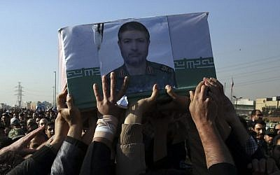 Civilians and armed forces members carry the coffin of Iranian Revolutionary Guard Brig. Gen. Mohammad Ali Allahdadi in his funeral ceremony outside the Guard compound in Tehran, Iran, Wednesday, Jan. 21, 2015 (photo credit: AP/Vahid Salemi)