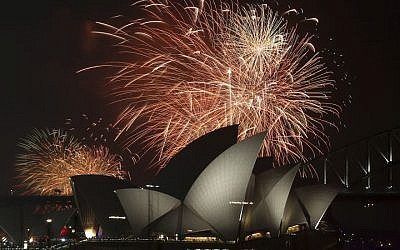 Illustrative: Fireworks explode over the Opera House and the Harbour Bridge during New Years Eve celebrations in Sydney, Australia, Wednesday, Dec. 31, 2014. (Photo credit: AP/Rob Griffith)