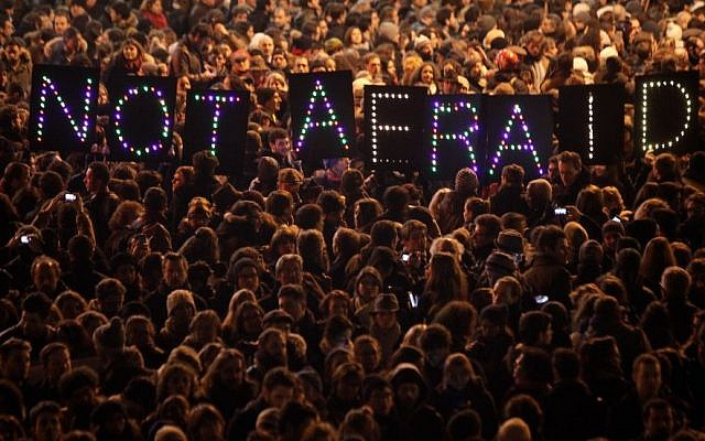 People gather in solidarity of the victims of a terror attack against a satirical newspaper, in Paris, Wednesday, Jan. 7, 2015. (Photo credit: AP/Thibault Camus)