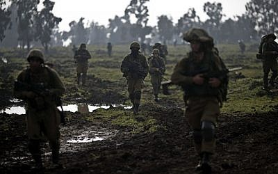 Israeli soldiers of the Golani Brigade training in the Israeli-controlled Golan Heights, near the Israel-Syria border, January 19, 2015. (photo credit: AP/Ariel Schalit)