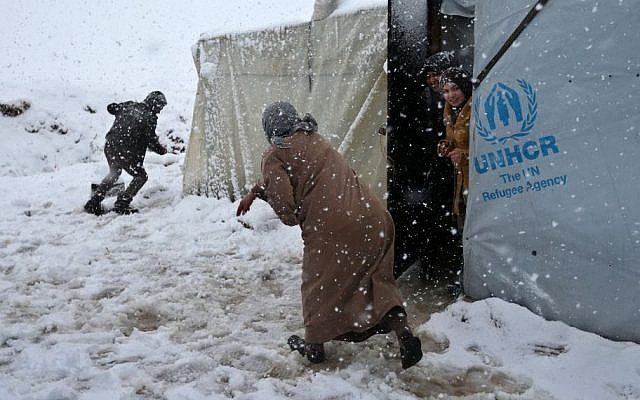 Syrians throw snow at each other at a refugee camp in Deir Zannoun village, in the Bekaa valley, east Lebanon, Wednesday, Jan. 7, 2015. (Photo credit: AP/Hussein Malla)