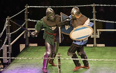 """An Israeli """"knight"""" (right) spars with an opponent at the World Medieval Fighting Championship, Rishon LeZion, January 22, 2015. (photo credit: Ariel Shrooster)"""